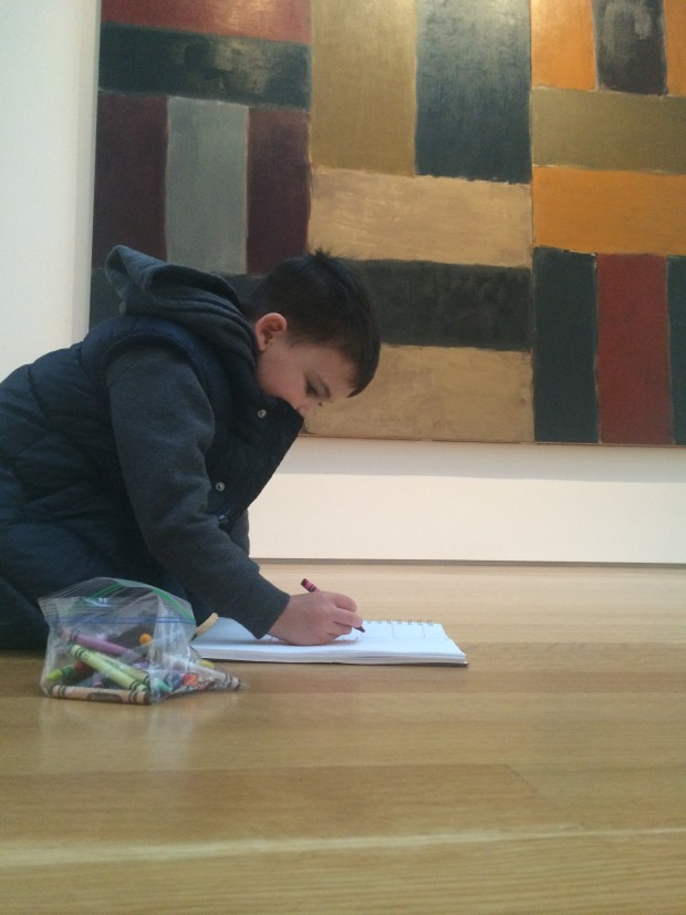 That's Jack, hanging out at the North Carolina Museum of Art, drawing a picture. And not getting trampled by swarms of people, because, well, NOT New York.